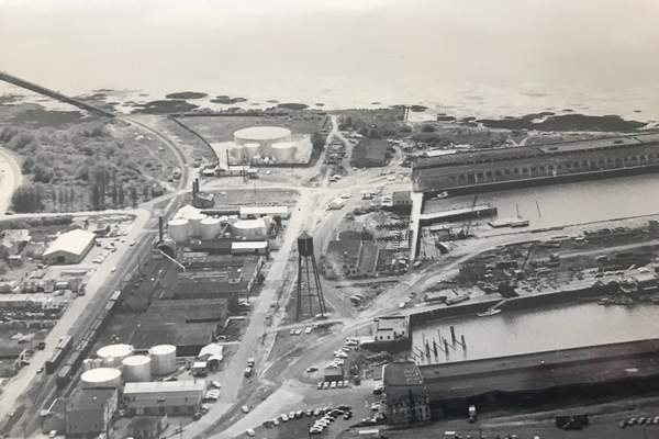 The Port of Astoria's central waterfront used to be populated with bulk fuel plants, seen on the left in this photo. An oil sheen in the Columbia River in the 1990s initiated a multimillion-dollar cleanup effort nearing a final solution.</p>(Clatsop County Historical Society)