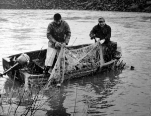 In this 1960's photo, Billy Frank Jr., left, fishes on the Nisqually River near Olympia, Wash., with his half brother Don McCloud. Frank, a Nisqually tribal elder, was arrested dozens of times while trying to assert his native fishing rights during the Fish Wars of the 1960s and '70s,. (AP Photo/Courtesy Northwest Indian Fisheries Commission)