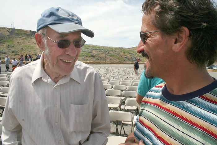 Bob Kress, left, shares a laugh with Scott Levy during a celebration of the 50th anniversary of completion of construction at Ice Harbor Dam. A project engineer during construction, Kress helped oversee installation of the dam's turbines and other equipment. (Andy Porter photo)