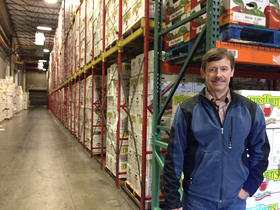Jim Hazen of Broetje Orchards is trying not to stress out as boxes pile high in the Prescott, Washinton company's cold storage facility. He estimates they have about a small Safeways worth of fruit for export held up by port delays. (photo Anna King)