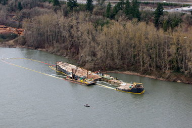 (Bruce Ely photo) The barge Davy Crockett in 2011, moored in the Columbia River in 2011 after a scrapping operation failed.