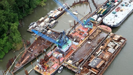 In 2011, government contractors built a cofferdam around the Davy Crockett so it could be deconstructed in the water. Workers removed 38,397 gallons of bunker oil. | credit: Washington State Department of Ecology.