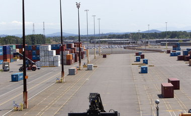 (Ross William Hamilton) Terminal 6, usually stacked full of containers, has relatively few boxes waiting for shipping abroad, as steamship lines bypass Portland because of labor disputes.