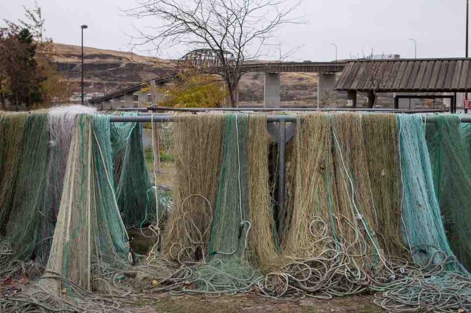 Tribal fishering nets dry on racks along the Columbia River at the Maryhill site. (Thomas Boyd photo)