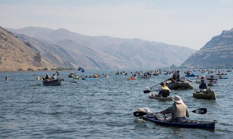 The annual Free The Snake Floatilla brought participants from the Seattle-area, Idaho, Spokane and elsewhere to advocate for the removal of the four Lower Snake River dams. (Eli Francovich / The Spokesman Review)