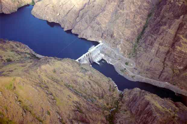 Aerial view of Hells Canyon Dam and the reservoir it backs up to Oxbow Dam (not visible) which impounds water up to Brownlee Dam.  Three comprising the Hells Canyon Project owned and operated by Idaho Power.