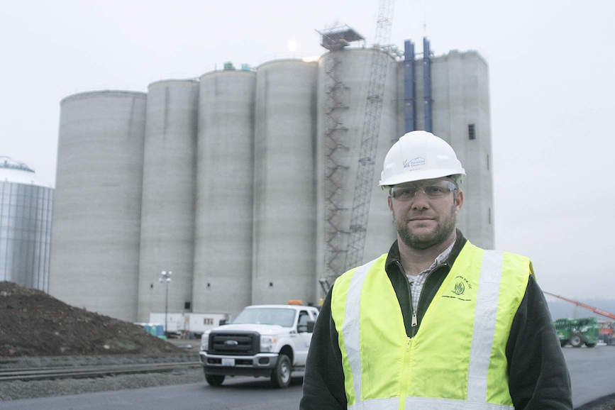 HighLine Grain terminal superindendent Brad Wiley stands outside the facility during construction November 6 near Four Lakes, Washington.  The terminal is slated to open in late January.