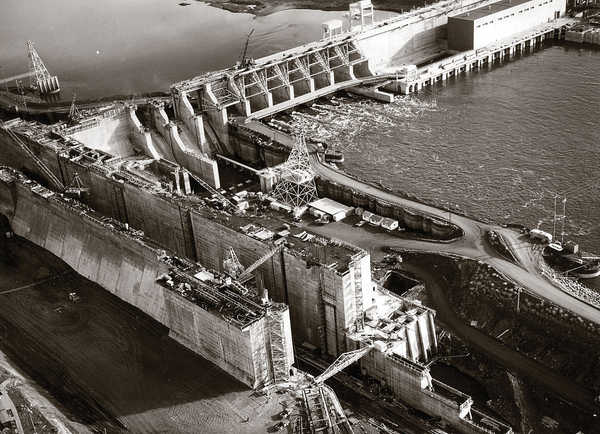 Heavy equipment works on the Franklin County side of the Ice Harbor Dam project on the Snake River nearing the completion of the massive concrete structure in 1962. A 50th anniversary celebration and dam open house is scheduled for June 16. (ACOE photo)