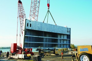 (Army Corps of Engineers) Crews from Advanced American Construction of Portland load the final quarter section of the new John Day navigation lock downstream gate onto a barge in Vancouver, Wash., on Nov. 23. The gate section is about 30 feet tall and 98 feet wide and weighs about half a million pounds.