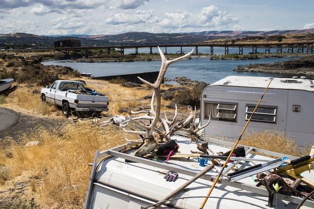 Lone Pine, located at the base of The Dalles Dam, is filled with the ramshackle housing of tribal members who make their living along the Columbia River. Many lived there before the dam was built. (Thomas Boyd photo)