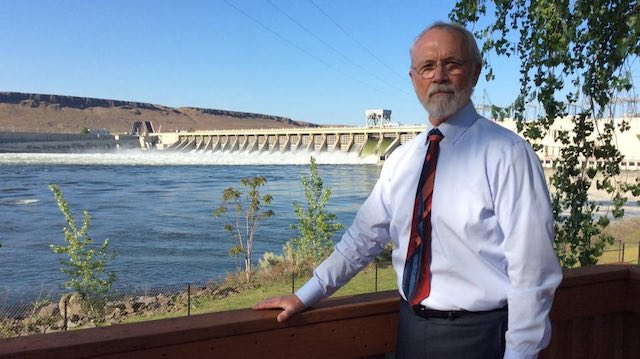 Rep. Dan Newhouse, R-Wash., visited McNary Dam on the Columbia River Wednesday for a tour as the plant operated under a U.S. court order to spill more water over the dam through the spring. (Annette Cary photo)
