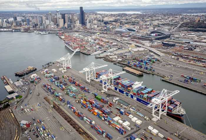 The container ship Benjamin Franklin calls at Terminal 18 of the Port of Seattle.  West Coast container port operators and the union representing longshoremen have agreed to hold further talks to extend their contract and avoid a work slowdown.