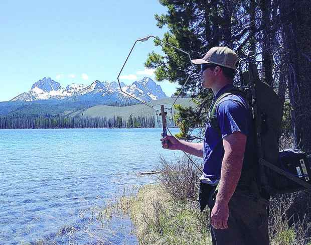 (Gordon Axel, NOAA) Technology is giving biologists the ability to get more data from more locations on spawning salmon. Here, Jesse Lamb, a scientist with the Northwest Fisheries Science Center, uses a mobile tracking device at Idaho's Little Redfish Lake.