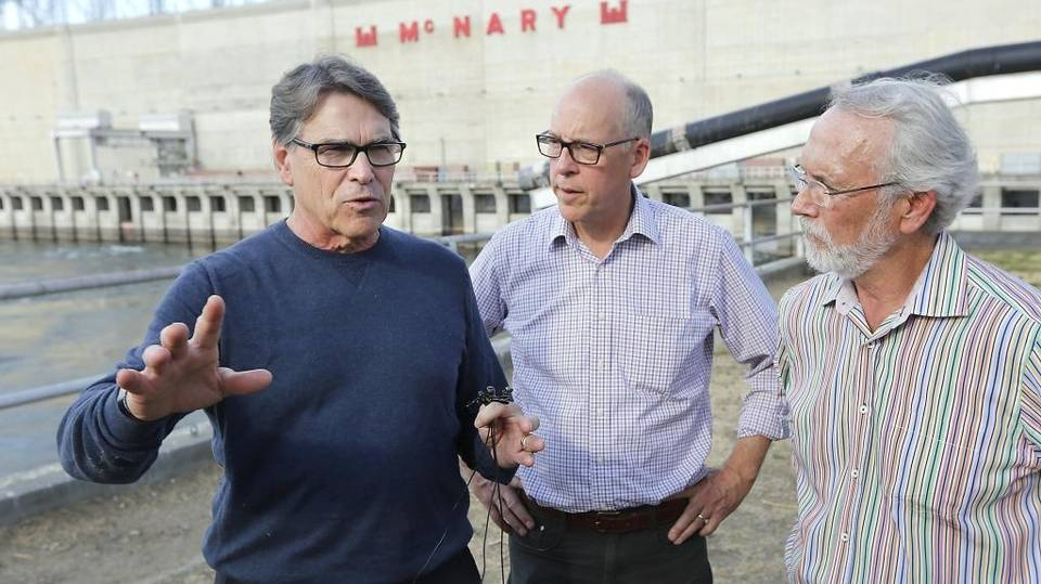 Energy Secretary Rick Perry, left, toured McNary Dam with Rep. Greg Walden R-Ore. and Rep. Dan Newhouse, R-Wash., right, in August. He said he supports using the Snake and Columbia river dams to generate electricity. File Tri-City Herald