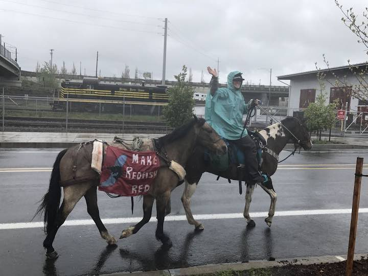 Three Idaho women road their horses through downtown Portland on April 24, 2017, part of a 900-mile journey to raise awareness of the plight of salmon in Idaho. (Andrew Theen photo)