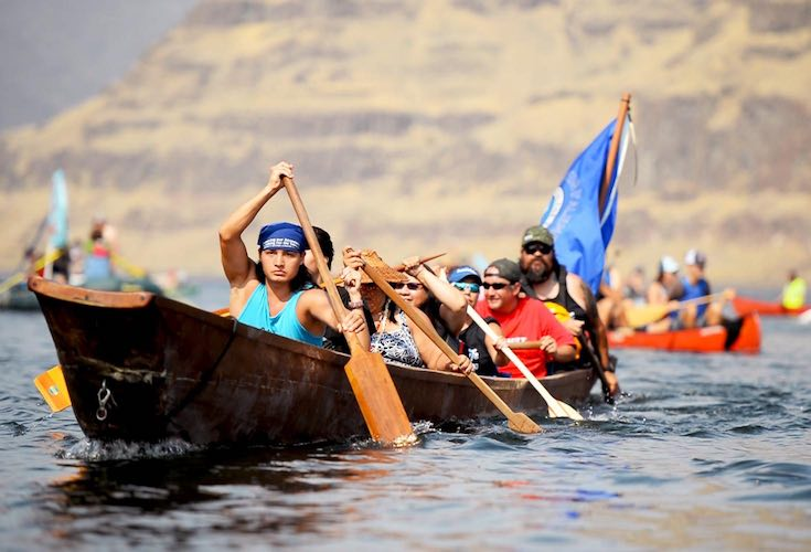 Nez Perce Tribal members paddle down the river Saturday afternoon at the 'Free the Snake Flotilla' (Rachel Sun photo)