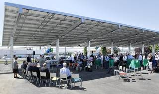 About 80 people gather Wednesday for a dedication ceremony of the new Franklin PUD community solar carport structure at 1411 W. Clark St. in Pasco.