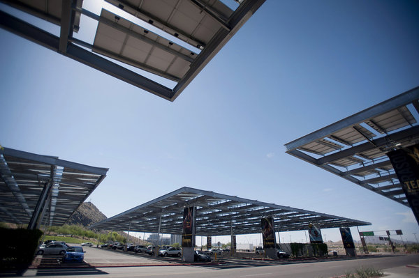 Solar photovoltaic energy produces clean energy while at the same time providing shade to cars in a parking lot.