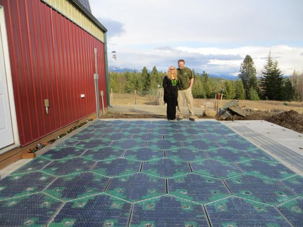 Solar Roadways co-founders Julie and Scott Brusaw stand by a demonstration pad of their solar roadway tiles.