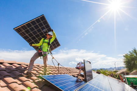 Solar goes up on a rooftop in Nevada, bringing benefits to all electricity customers.
