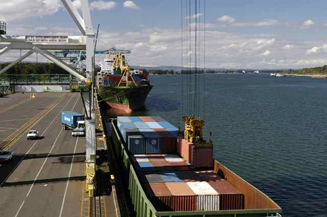 Containers are unloaded from a river barge at Terminal 6 Port of Portland.