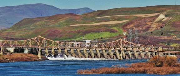 The Dalles Dam is shown behind The Dalles Bridge on the Columbia River in The Dalles, Oregon.