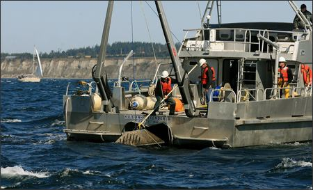 A crew from Evans Hamilton, a nationwide oceanographic consulting firm, on Wednesday removes equipment that measures tidal currents from Puget Sound in Admiralty Inlet off Whidbey Island.