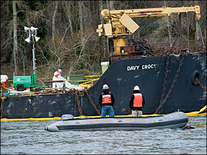 A crew from Ballard Diving stands by as one of their divers checks the condition of the Davy Crockett on the Columbia River near Camas, Wash., 1/31/11.