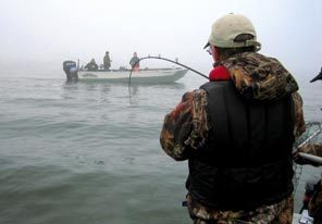 Joe Hymer, a state Fish and Wildlife biologist, reels in a spring chinook salmon on the Lower Columbia River.
