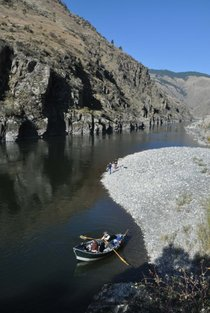 Salmon River fishing guide Norm Klobetanz rows his drift boat off a gravel bar to resume steelhead fishing with Amy Sinclair, co-owner of Exodus Wilderness Adventures based in Riggins, Idaho.