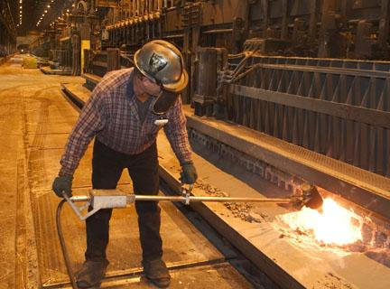 A Columbia Falls Aluminum Company worker is seen in this file photo.