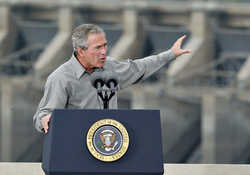 (Paul Erickson) Former President George W. Bush assures a crowd above Ice Harbor Dam in 2003 that the dams on the Snake River were not in jeopardy of being breached while he was in office. During the decade, Bush and most Republicans were embraced by a strong majority of Mid-Columbia voters.