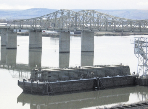 (Matthew Weaver) Tri Cities Grain in Pasco, Wash., was ready to load this 90,000-bushel barge from Tidewater Barge Lines, located on the Snake River near the Snake River Bridge on March 18, in anticipation of the Columbia-Snake River system's reopening.