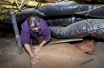 (Doug Beghtel) Adam Zielinski with Sustainable Solution crawls under a Lake Oswego home in 2009 to look for problems in the old duct works. A federal agency says the Northwest can use efficiency improvements in homes, business and the grid to meet most of the region's new energy demand.