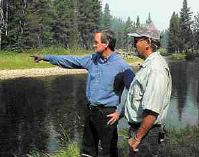 Idaho Senator Mike Crapo talks with Idaho Fish & Game Fisheries Biologist Don Anderson Tuesday about the fire's effect on salmon runs along the Secesh River north of McCall.  The Secesh River borders the fire lines of the Burgdorf fire.