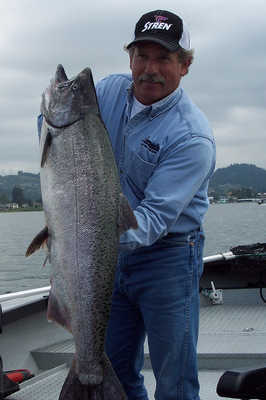 Jack Glass displays the 25-pound spring chinook salmon taken in the Sandy River, the largest fish he's guided to this season.
