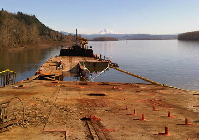 (WA Dept. of Ecology) The beached former Liberty ship Davy Crockett was run aground on the Columbia River near Camas last week. Structural instability is complicating efforts to locate the source of oil leaking from the vessel.