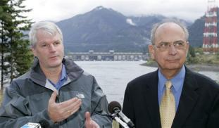 U.S. Reps. Doc Hastings, R-Wash, right, and Brian Baird, D-Wash., stand near Bonneville Dam and the Columbia River in North Bonneville, Wash., Monday, Oct. 16, 2006, as they announce a new legislative initiative aimed at protecting endangered Columbia River salmon and steelhead from sea lion predation. Fishery officials have tried just about everything to keep sea lions from munching on threatened