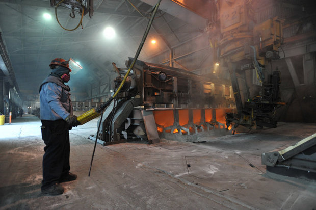 (Philip A. Dwyer) Worker Kevin Daniels works on a recently started aluminum smelter pot on potline B at the Alcoa Intalco aluminum smelter west of Ferndale, Tuesday afternoon, Feb. 15, 2011. Intalco has also hired 60 more people.