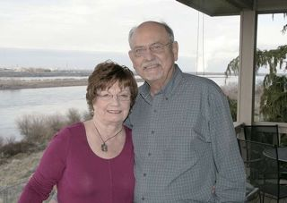 (Dan Wheat photo) Former Congressman Doc Hastings and his wife, Claire, stand on the deck of their home overlooking the Columbia River just north of Pasco, Wash., on Jan. 15, 2015.