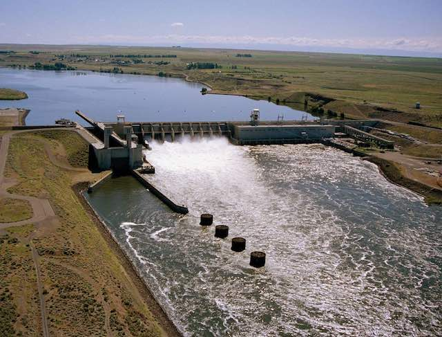 Water pours through the Ice Harbor Dam on the Snake River east of  Pasco. It is one of four lower Snake River dams covered in an environmental review that will look at whether removing the dams is the best option to improve salmon runs.