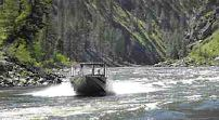 (Darin Oswald) A jet boat glides up the Salmon River, negotiating the river currents and whitewater.