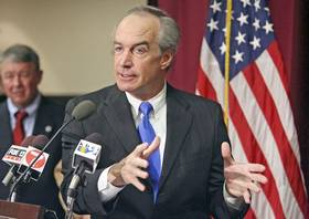(Darin Oswald) Interior Secretary Dirk Kempthorne takes questions at a news conference before taking part in a