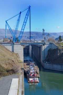 At The Dalles Dam on the Columbia River, Lampson International mobilized a Manitowoc 4100W, a Manitowoc 3900, a Grove 760E rough terrain crane and its Transi-Lift LTL-1100.'
