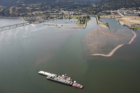(Thomas Boyd) A Tidewater Barge Lines fuel barge grounded without mishap in the Columbia River on July 9 near Hood River - the fifth of five grounding or collision incidents in 17 months. Tidewater offloaded to another barge about 500,000 gallons of gasoline to refloat the stuck barge and get it on its way upriver.