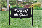 Keep off the grass sign on a lush lawn