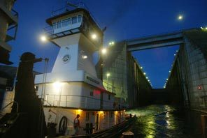 The tug Lewiston emerges from the locks at Lower Granite Dam just after dusk having been lowered about 100-feet.