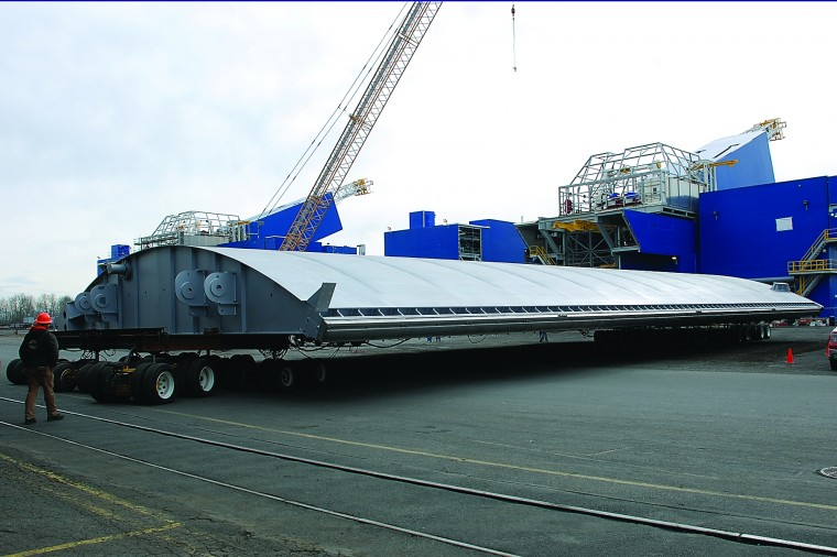 The first leaf of the new The Dalles navigation lock downstream gate rolls out of Thompson Metal Fab's shop in Vancouver, Wash., on Friday.