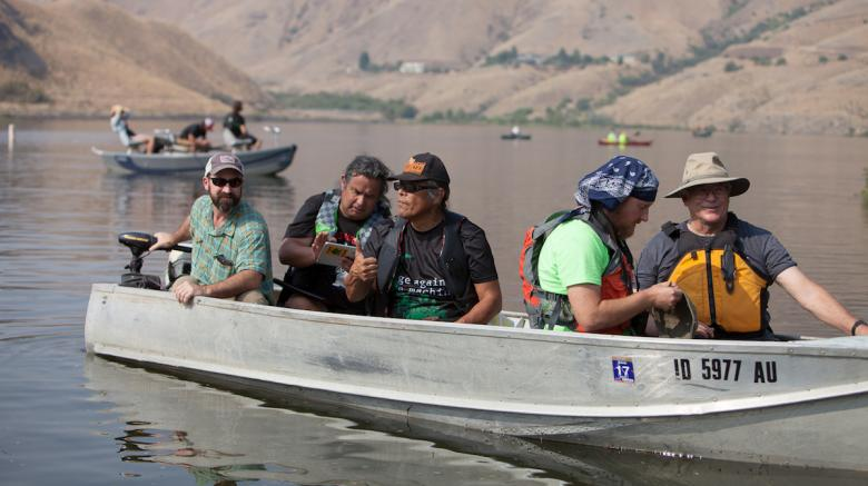 Members of the Nimiipuu (Nez Perce) take part in the Free the Snake Flotilla in protest of four dams on the lower Snake River. The dams have been blamed for warming the water on the river and killing off millions of salmon. (Photo by Mike Lee)