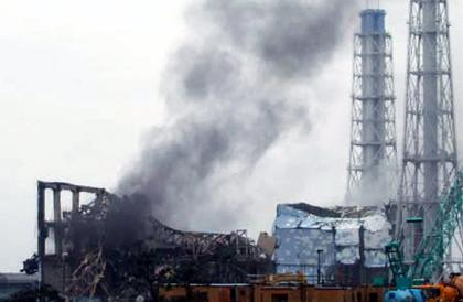 Black smoke rises March 21 from reactor No. 3 of Japan's Fukushima Dai-ichi Nuclear Power Station, where engineers have been working to fix disabled cooling systems